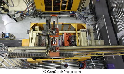 Factory Robotics Top View - A birds eye view of a robotic...
