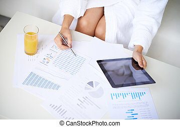 Working at home - Close-up of girl in bathrobe with touchpad...