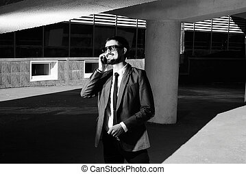 Business agent - Black-and-white image of a smiling...