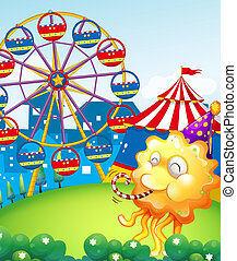 An amusement park at the hilltop with an orange monster -...