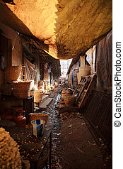 Dirty back alley in India - Dirty back alley at a market in...