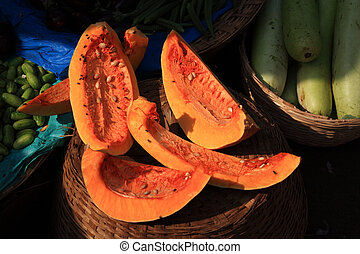 Fruit covered in flies India - Fruit covered in flies at a...