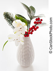 Christmas flower arrangement - Sprigs of holly with hoar...