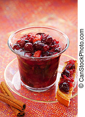 Apple and cranberry chutney with spices in a jar