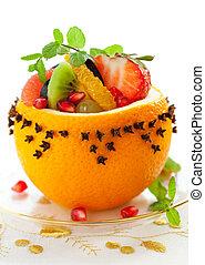 Fruit dessert - Fruit salad in hollowed-out oranges studded...