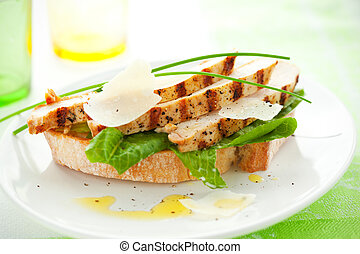 chicken Caesar sandwich - Open chicken Caesar sandwich on...