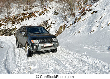 Car on the snow road - Car on the road in winter on the...