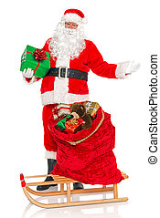 Santa with sack of toys and sledge isolated