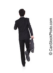 back view of a business man running