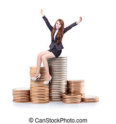 Excited business woman sitting on money and raise arms...