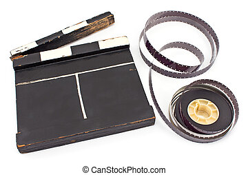Vintage movie clapboard and 16 mm film reel isolated on...