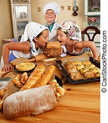 Happy children with table full of homemade pastry