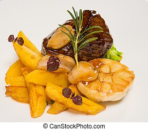 Meat with french fries and vegetables