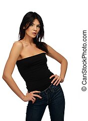 Young beautiful brunette woman in black top and jeans isolated on white background