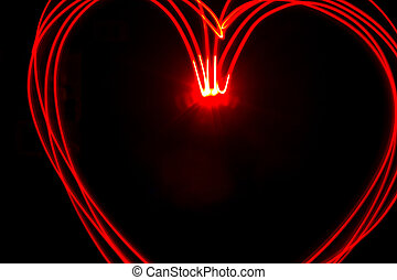 Red heart light painting - Multiple red heart light streaks...