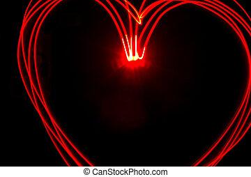 Red heart light painting - Multiple red heart light streaks...