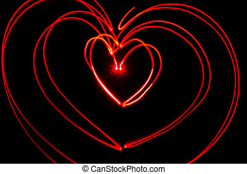 Red heart light painting - Red heart shaped light streaks...