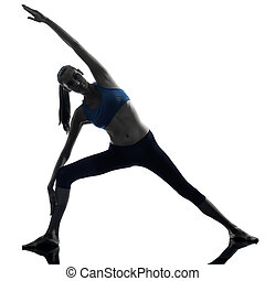 woman exercising stretching triangle pose yoga - one...