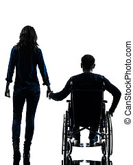 one handicapped man and woman holding hands in silhouette...