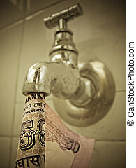 water tap with fifty rupees Indian banknote, Concept