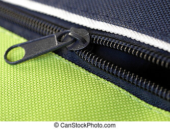 zip - Zipper or zip fastener joining two edges of fabric