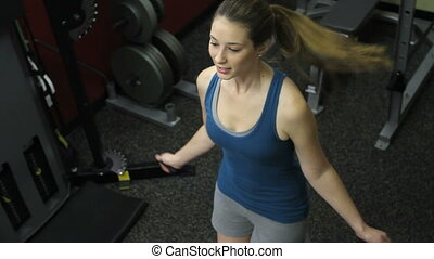 Female Jump Rope in Gym 1 - High angle of a woman doing jump...
