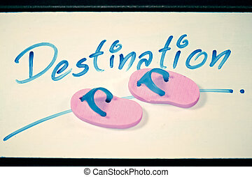 Miniature rubber slippers with wording Destination, Concept