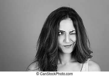 brunette woman making faces - black and white portrait of a...