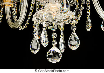 Contemporary glass chandelier fragment isolated over black...