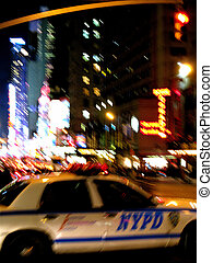 New York Poilce Car at night - blurred view of NYPD car in...