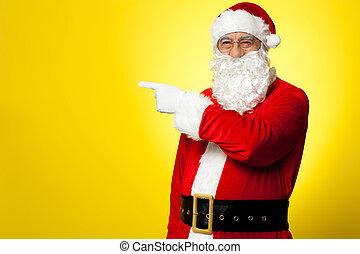Santa pointing away towards something