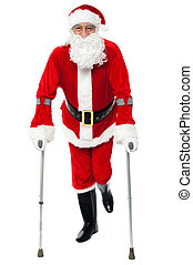 Santa walking with the help of crutches - Male santa claus...