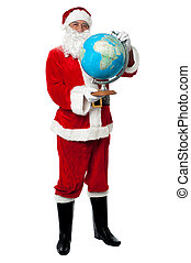 Male santa holding a globe map