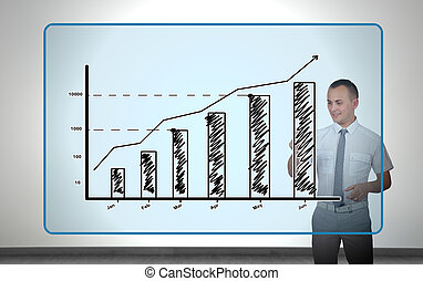presses graphic - young businessman presses graphic on...