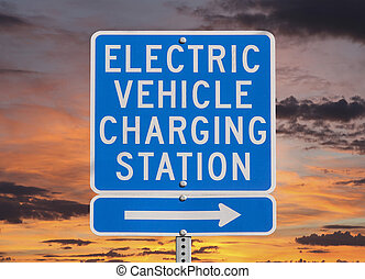 Electric Vehicle Charging Station Sign with Sunset Sky