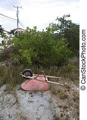 Wheelbarrel in the Sand - An upside-down wheelbarrel in the...