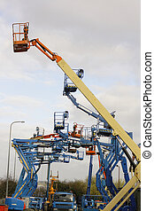 cherry picker - a full reach cherry picker in a yard contain...