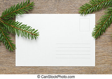 christmas background from fir twigs on wooden table,...