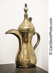 Omani coffee pot - A traditional Omani brass coffee pot on a...