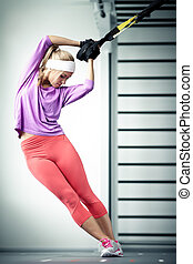 training - Young woman streching muscles training