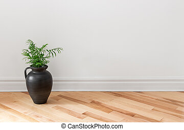 Amphora with green plant decorating a room - Amphora with...