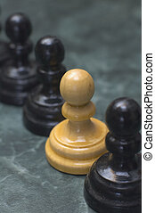 difference - white chess man figure between black ones