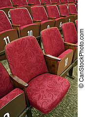 theatre seats - red theatre seats with white numbers, one...
