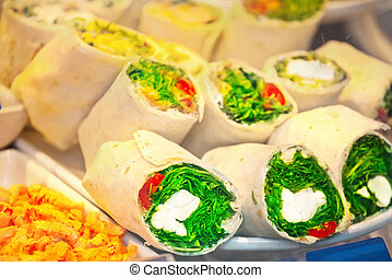 Rolls with cream cheese and shrimp salad on fastfood counter...
