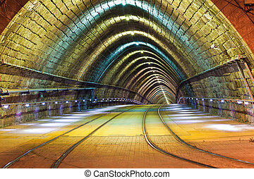 tunnel for the city tram at night - Empty tunnel for the...