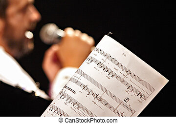 music sheet at a concert in focus