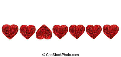 Red beaded hearts isolated against white background