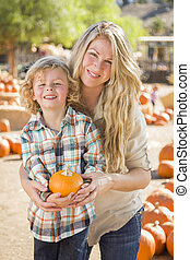 Attractive Mother and Son Portrait at the Pumpkin Patch -...