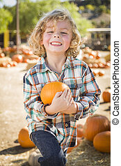Little Boy Holding His Pumpkin at a Pumpkin Patch - Adorable...