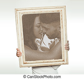 Woman holding a romantic picture
